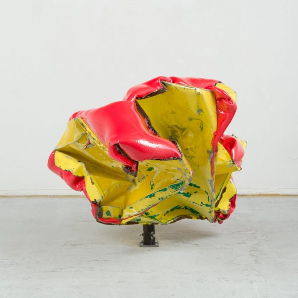 a sculpture made of crushed metal and yoga mats. Red and yellow