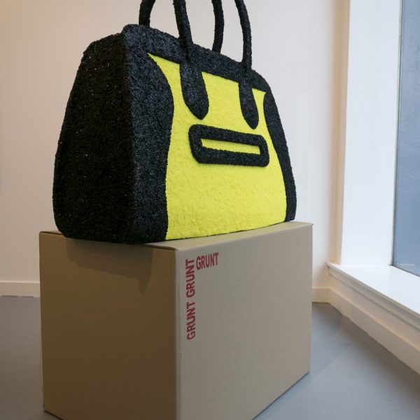 an oversized black and florescent yellow handbag