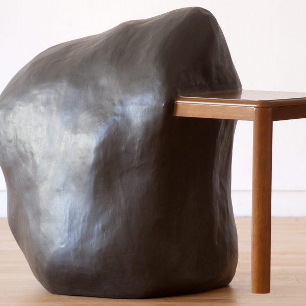 a table partially consumed by a grey blob